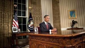 El presidente Obama sentado